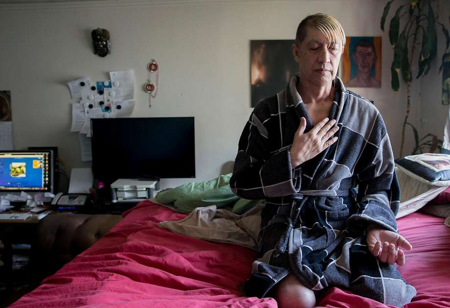 Jesus Guillen, a long-term HIV survivor, meditates in his bedroom before starting the day. Photo: Jessica Christian / The Chronicle