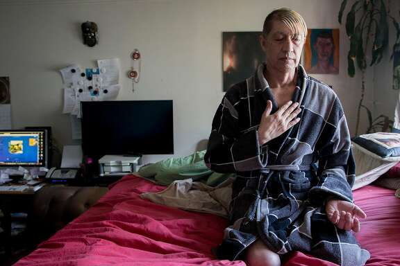 Jesus Guillen, a longterm HIV survivor, takes a moment to meditate in his bedroom before starting his day in San Francisco, Calif. Thursday, Oct. 18, 2018.