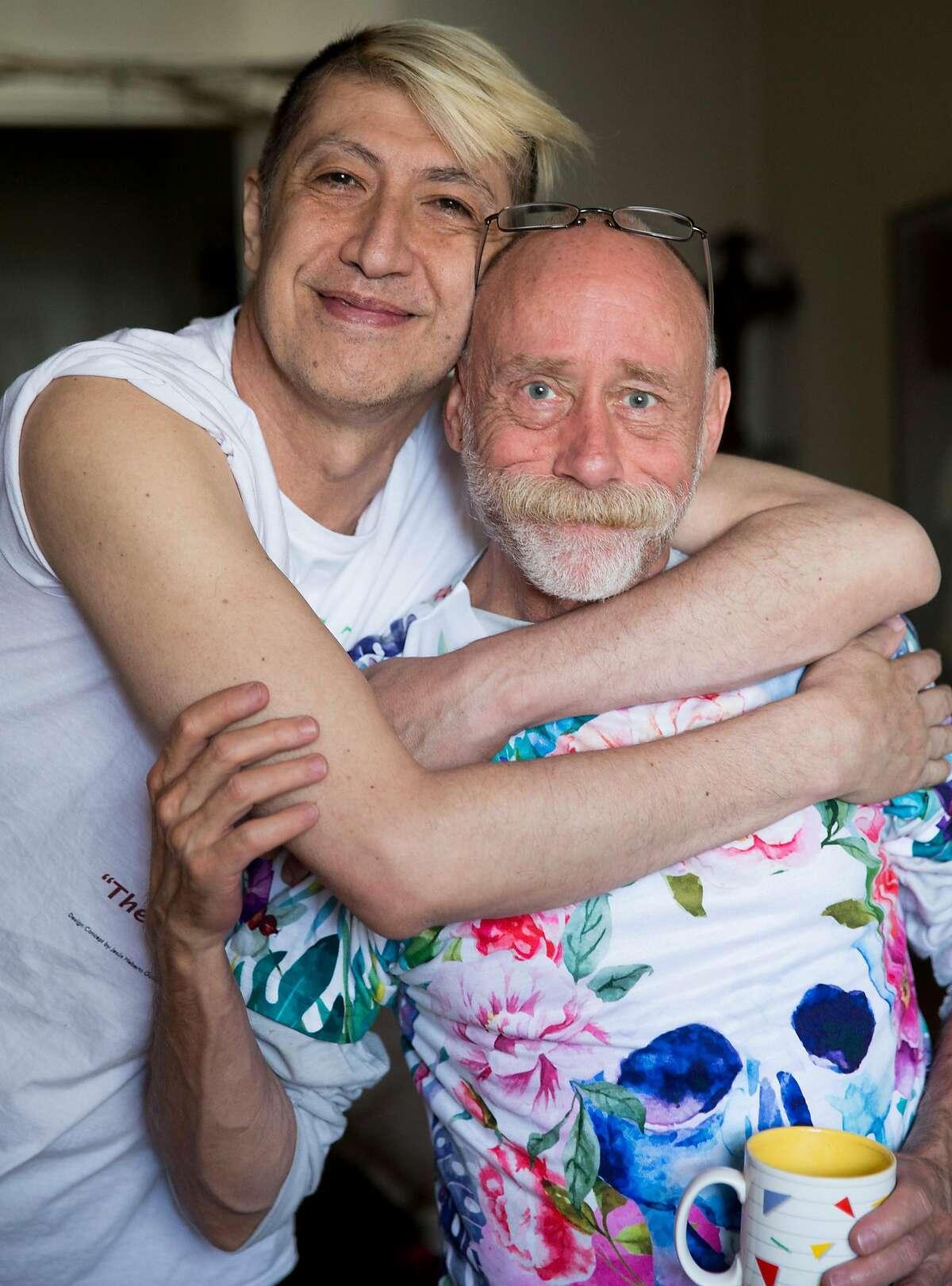 Jesus Guillen, a longterm HIV survivor, left, poses for a portrait with fellow longterm survivor Robert Riester of Denver, Colorado while at Guillen's apartment in San Francisco, Calif. Thursday, Oct. 18, 2018.