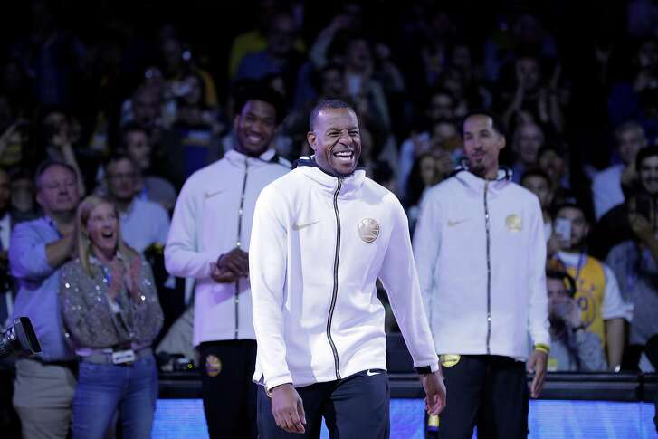 Andre Iguodala (9) smiles as he goes up to recieve his championship ring before the Golden State Warriors played the Oklahoma City Thunder at Oracle Arena in Oakland, Calif., on Tuesday, October 16, 2018. The Warriors received their 2018 NBA Championship rings and saw their championship banner raised in the arena