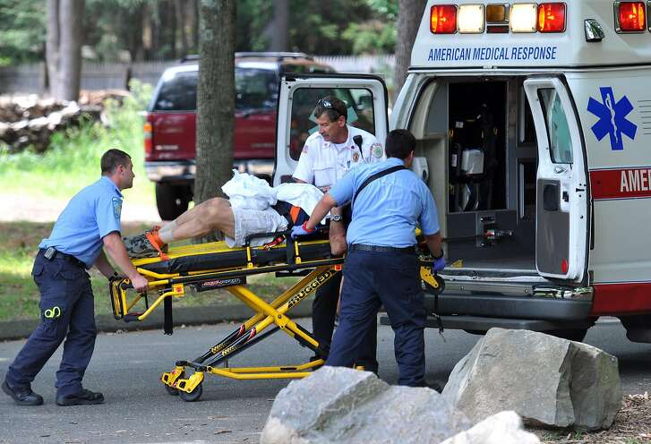 Hamden-- Hamden fire dept. and AMR EMT's place a man in an ambulance who required emergency assistance after a hiking injury at Sleeping Giant State Park. The Hamden fire department had two calls at the same time at Sleeping Giant, on different locations in the park.  Peter Casolino/New Haven Register 8/08/12