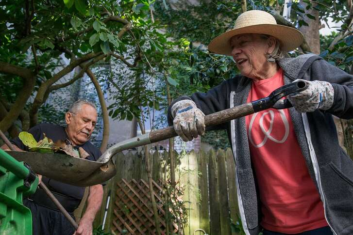 Airbnb hosts Rudolfo and Karen Cancino work on the backyard garden of their home in San Francisco, Calif. Thursday, Oct. 18, 2018.