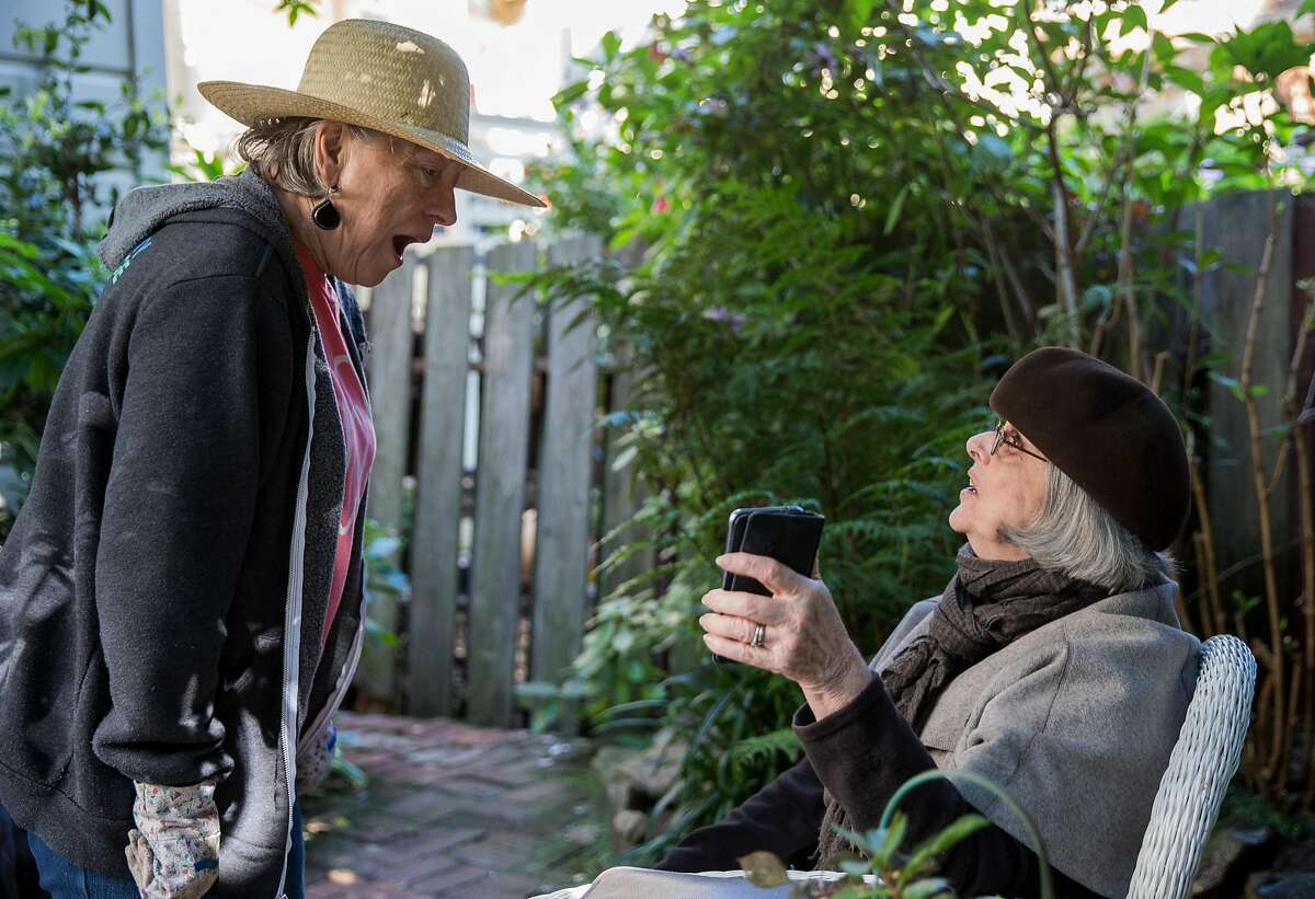 Airbnb host Karen Cancino, left, chats with her Airbnb guest Sue Conners of Sydney, Australia while in the garden of her home in San Francisco, Calif. Thursday, Oct. 18, 2018.