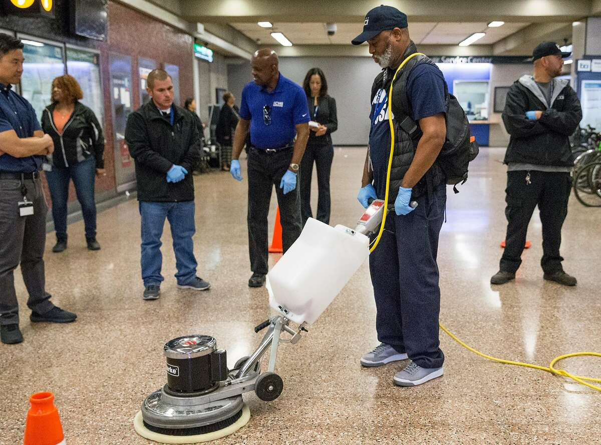 Bart System Service Worker Robert Ware, center, practices using a heavy duty power cleaner to clean up biohazards during a training session held at Lake Merritt Bart Station in Oakland, Calif. Friday, Oct. 19, 2018.