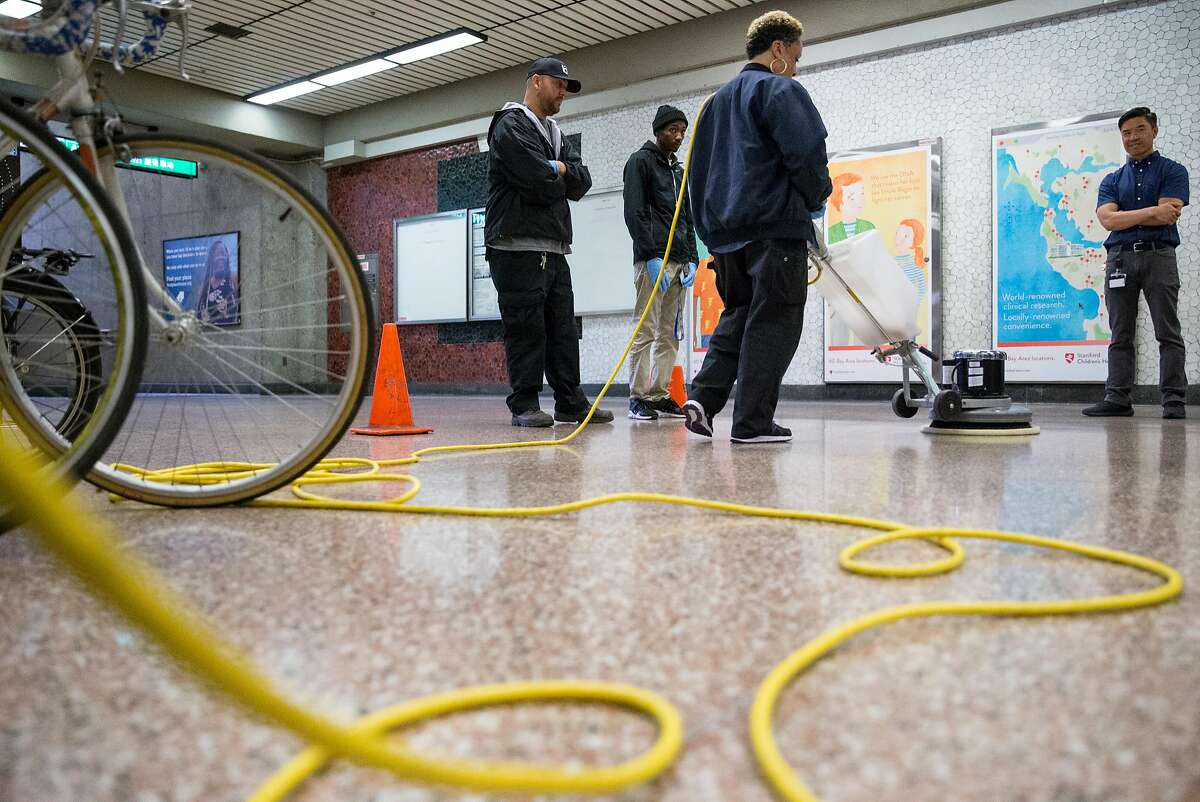 Bart System Service Worker Heather Oliver practices using a heavy duty power cleaner to clean up biohazards during a training session held at Lake Merritt Bart Station in Oakland, Calif. Friday, Oct. 19, 2018.
