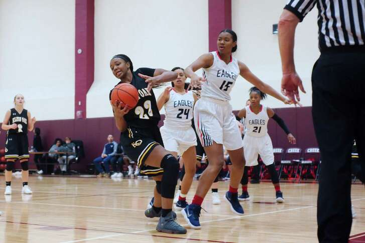 Klein Oak's Elizabeth Scott (22) and Atascocita's Elyssa Coleman (15) fight for a rebound during the Peggy Whitley Classic basketball tournament Thursday, Nov. 30 at Clear Creek High School.