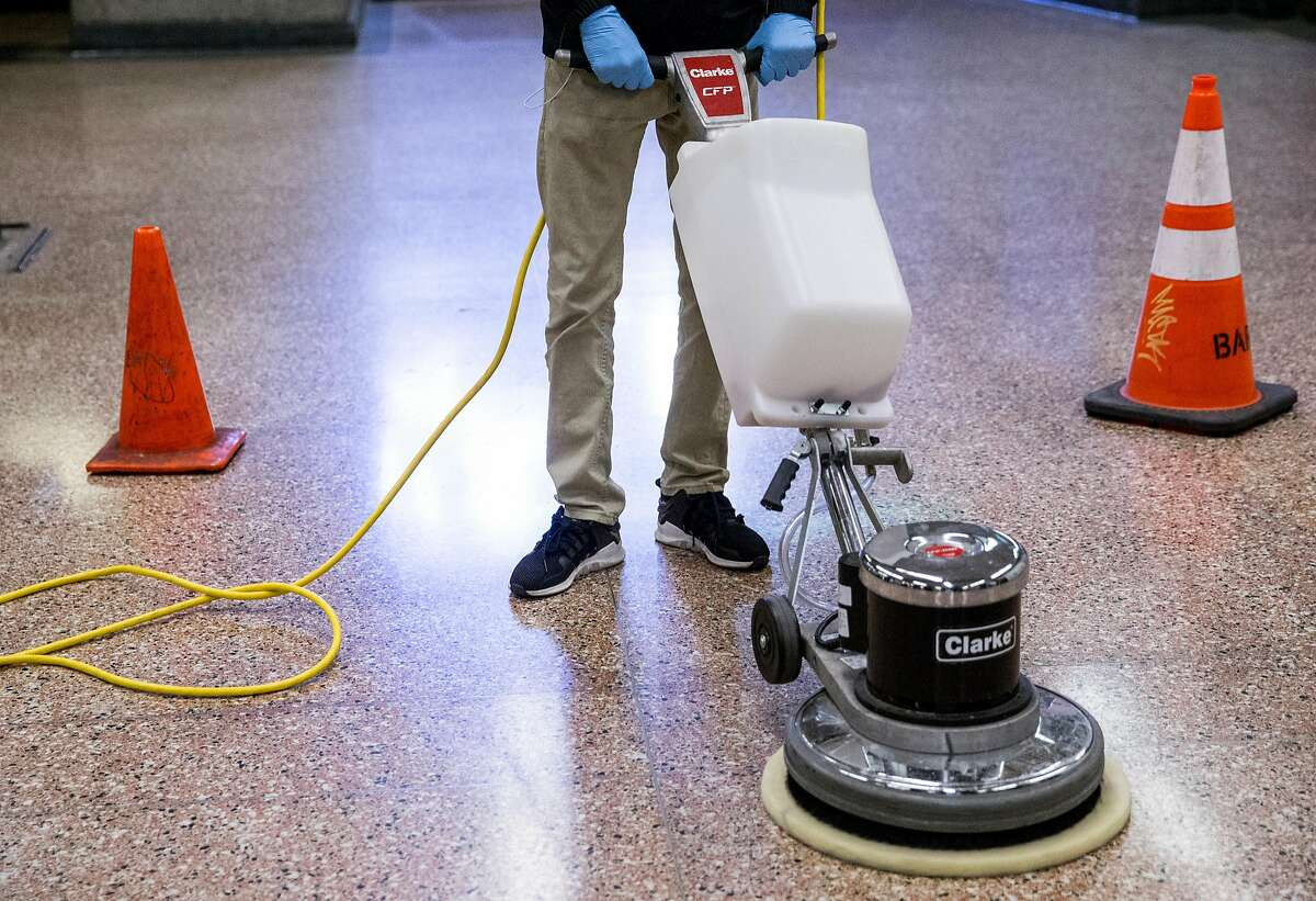 Bart System Service Worker Chad Briscoe practices using a heavy duty power cleaner to clean up biohazards during a training session held at Lake Merritt Bart Station in Oakland, Calif. Friday, Oct. 19, 2018.