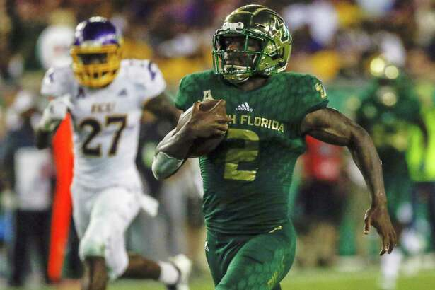Running back Jordan Cronkrite (2) and South Florida host UConn on Saturday.