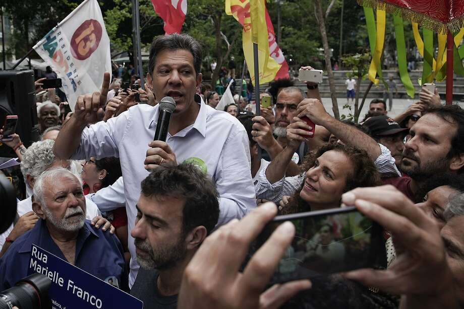 Fernando Haddad, candidate for the left-leaning Workers' Party, rallies Friday in Rio de Janeiro. Haddad says the messaging scheme, if real, would amount to illegal campaign practices. Photo: Leo Correa / Associated Press