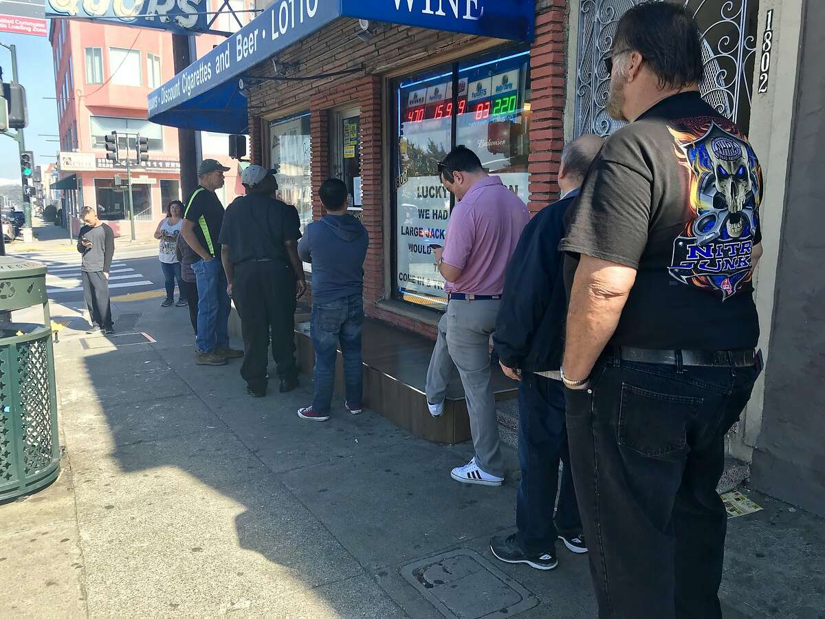 A line forms outside 19th Avenue Liquors in San Francisco as lottery ticket buyers wait for the owner to open the store.
