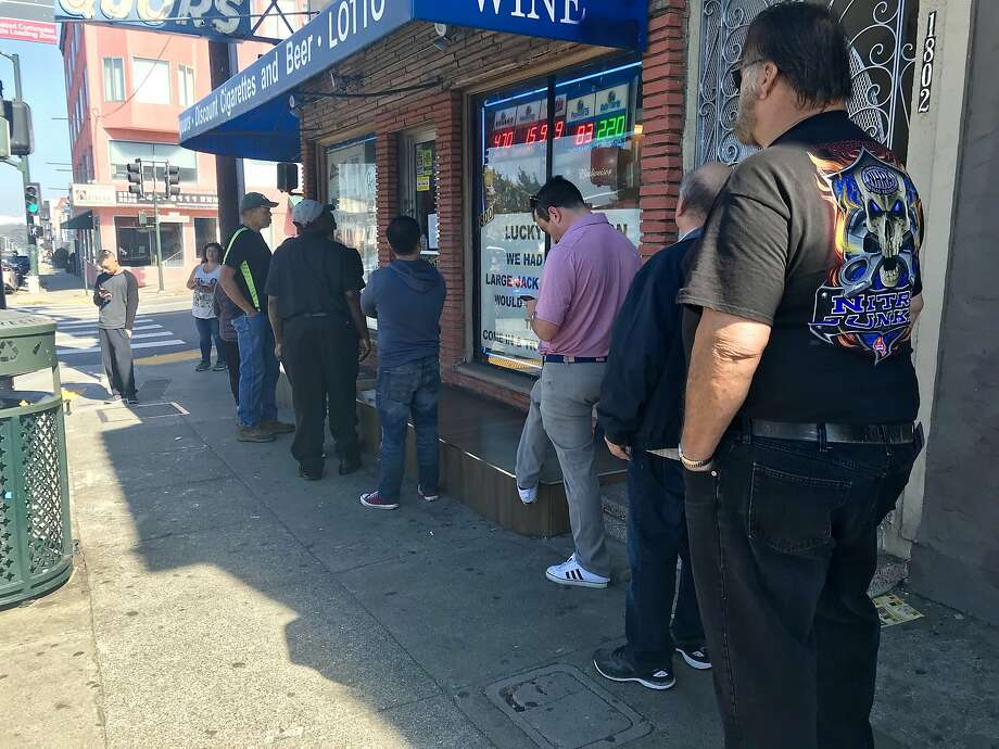 A line forms outside 19th Avenue Liquors in San Francisco as lottery ticket buyers wait for the owner to open the store. Photo: Ashley McBride / The Chronicle
