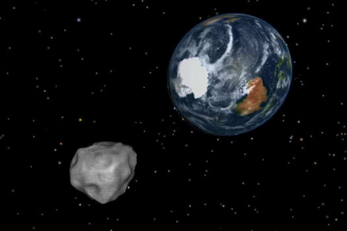 FILE - This NASA illustration depicts an asteroid during a close approach.