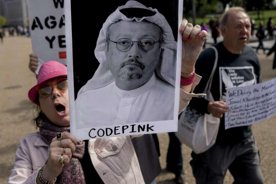 A Codepink demonstrator holds a photograph of journalist Jamal Khashoggi while marching outside the White House on Friday. Trump has enabled the behavior of despots, including the apparent murder of Khashoggi. Photo: Andrew Harrer /Bloomberg / © 2018 Bloomberg Finance LP