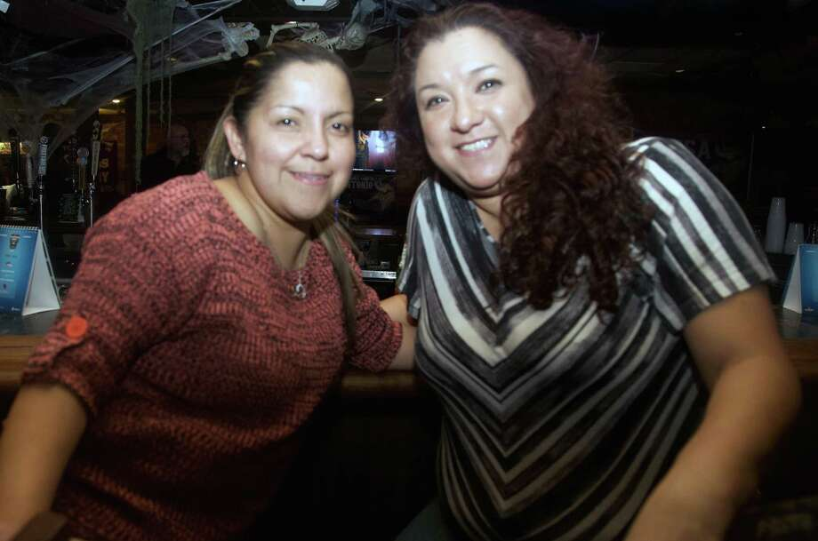 Brenda Elizando and Carmen Guzman get together at Rod Dog's Saloon. Photo: Xelina Flores /Photo Correspondent