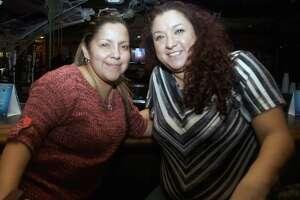 Brenda Elizando and Carmen Guzman get together at Rod Dog's Saloon.