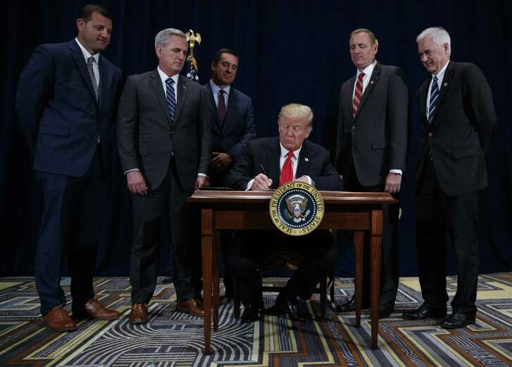 President Trump signs a memorandum designed to provide more water to California farms as Central Valley Reps. David Valadao (left), Kevin McCarthy, Devin Nunes, Jeff Denham and Tom McClintock look on in Scottsdale, Ariz.