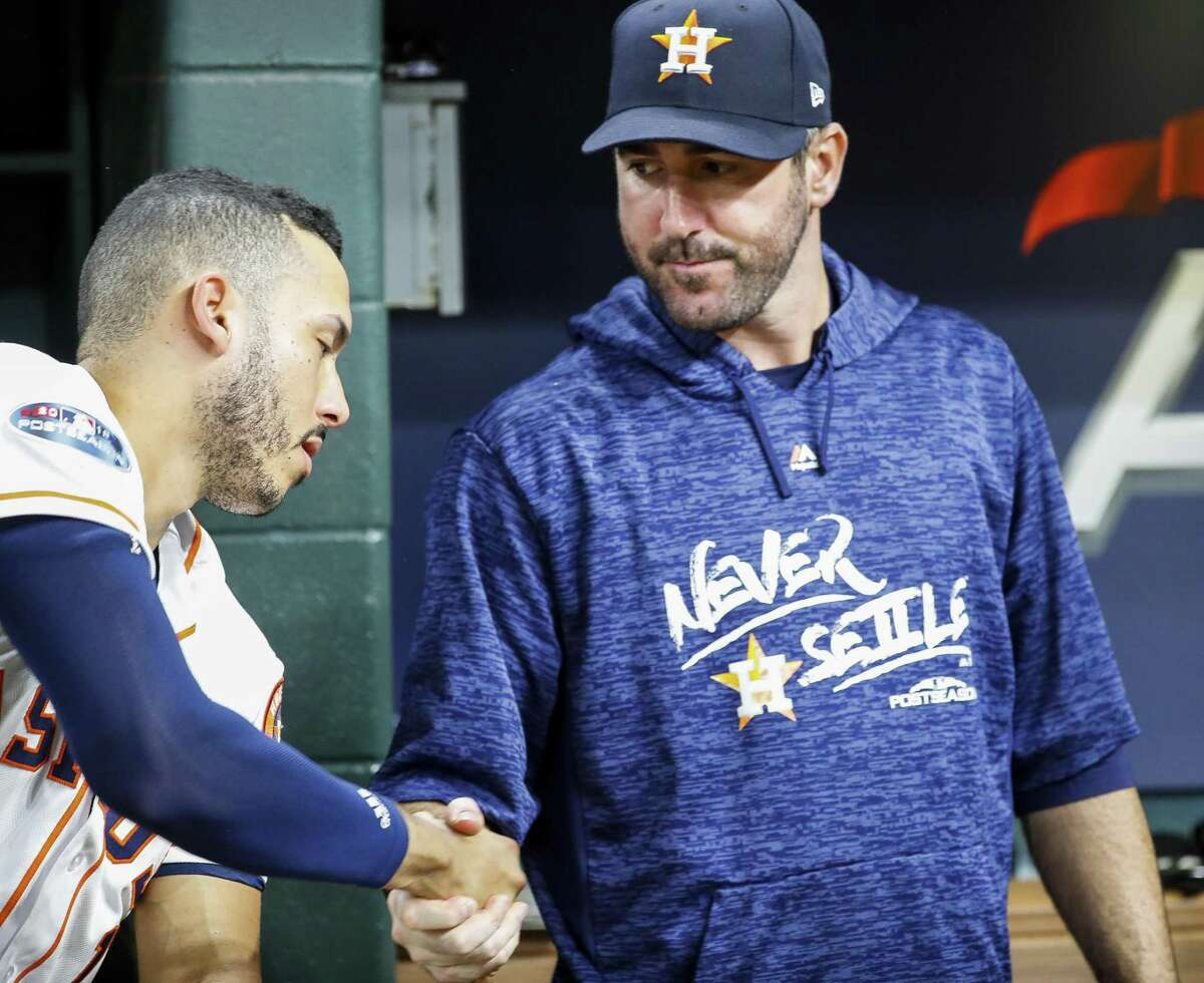 Houston Astros Carlos Correa (1) shakes hands with Houston Astros starting pitcher Justin Verlander (35) after Game 5 of the American League Championship Series at Minute Maid Park on Thursday, Oct. 18, 2018, in Houston.