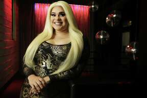 """This Sept. 23, 2018 photo shows Tatiana Mala-Nina before a performance at Rich's Houston in Houston. Mala-Nina is schedule to read at an upcoming """"Drag Queen Storytime"""" event at the Freed-Montrose Neighborhood Library. (Melissa Phillip/Houston Chronicle via AP)"""