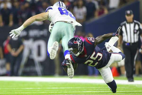 Despite being smallish in stature, Kareem Jackson, right, has played a physical, durable and versatile role in plugging any gaps in the Texans' injury-marred secondary this season while taking on the likes of Cowboys tight end Blake Jarwin and all comers.