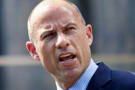 FILE - In this July 27, 2018 file photo, Michael Avenatti, the attorney for porn actress Stormy Daniels, talks to the media during a news conference in front of the U.S. Federal Courthouse in Los Angeles. In Washington and early battleground states, Michael Avenatti is pitching himself as a Democrat willing to take the fight to President Donald Trump in the 2020 election. (AP Photo/Richard Vogel)