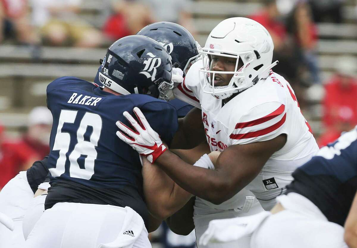 Ed Oliver, against Rice in the opener, routinely draws a crowd of blockers.