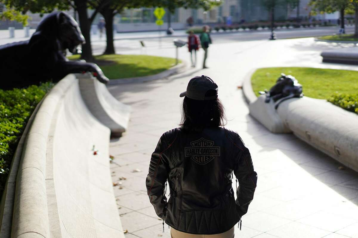 A woman, who once applied for a position with the Oakland Police Department - thinks it was her answer to a particular question that was the reason her application denial, stands in front of the National Police Memorial on Friday Oct. 19, 2018 in Washington D.C. - The Oakland Police Department, which has struggled to recruit women into its ranks, requires all officer applicants to disclose whether they have been sexually assaulted before they can be hired, The Chronicle has learned. Other large-city PDs in California say they do not ask the question, and officials in Oakland could not give a clear reason as to why that question is part of their application process, other than to point out that they want to know if applicants have been involved in any police reports, either as victims, witnesses or accused.