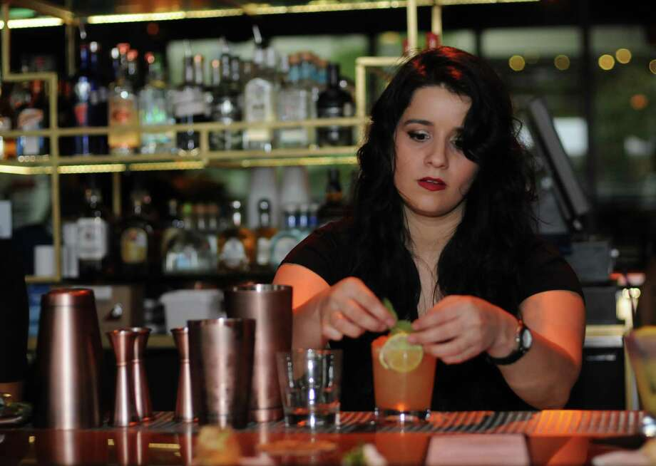 Belle Rivera makes a drink at Merkaba, which is now open at 111 W. Crockett St., Suite 205 on the River Walk. Photo: Paul Stephen / Staff