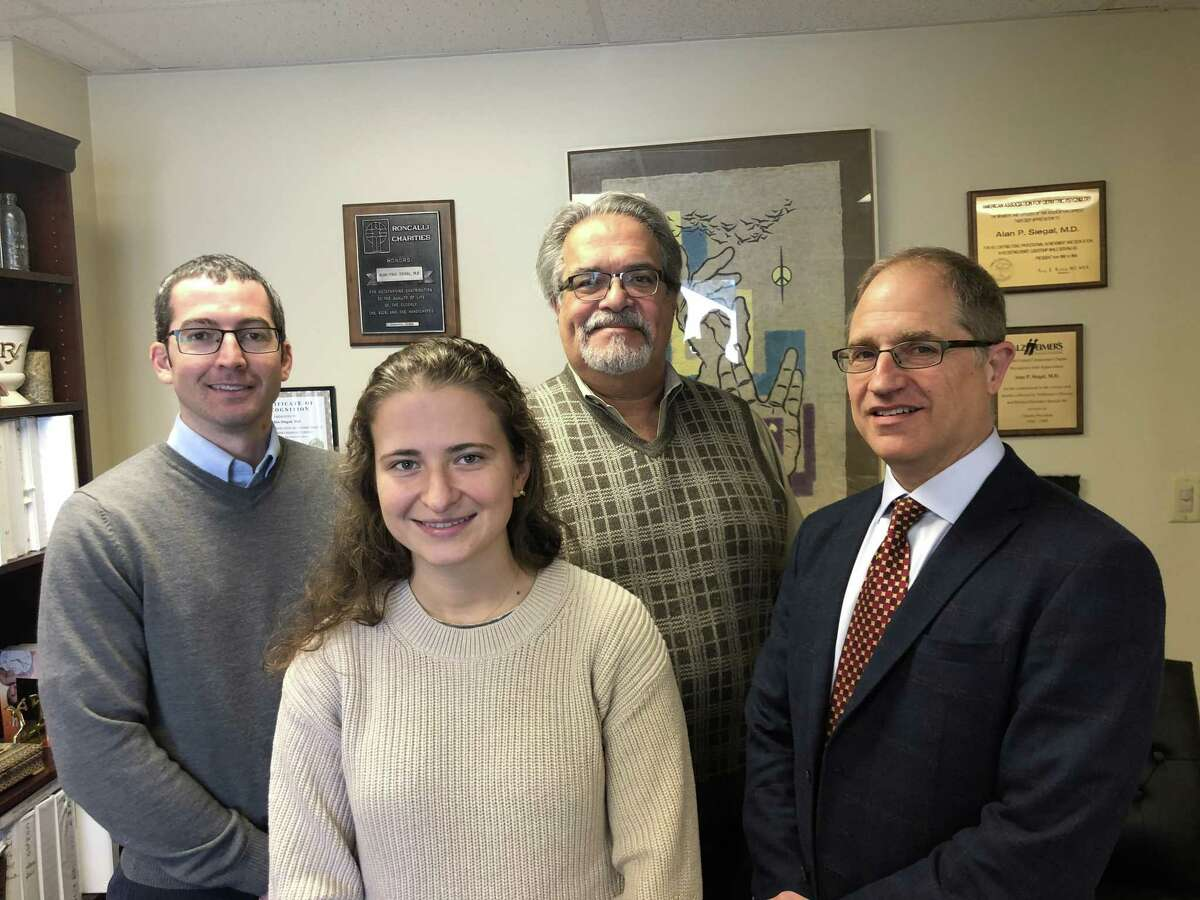 From left, Dr. Adam Mecca of the Yale Alzheimer's Disease Research Unit, Sylwia Lipior, clinical research coordinator at the unit, Dr. Alan Siegal, psychiatrist at Geriatric and Adult Psychiatry in Hamden, and Dr. Robert Berman, chief medical officer of Biohaven Pharmaceuticals in New Haven.