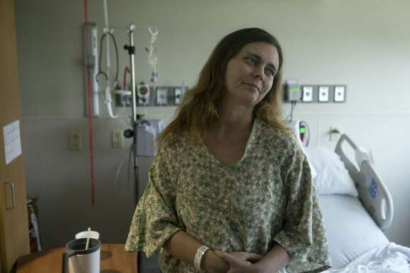 Asten Jones sits in her hospital room at Methodist Hospital, where charitable funds paid for her treatment with antibiotics. The infection in her heart was caused by the use of dirty needles to inject illegal drugs.