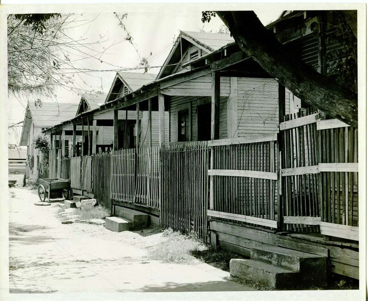 An undated exhibit photo shows some of the housing conditions among the poorest on the West Side.