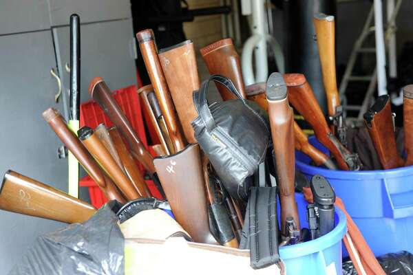 Some of the more than 100 guns collected Saturday, July 18, 2015, during Bridgeport's Gun Buyback initiative Saturday, July 18, 2015, at the Police Department Community Services Division at 1395 Sylvan Ave. The Bridgeport Police Department offered up to $200 for a working handgun, up to $100 for a rifle and a weapon determined to be an assault rifle was eligible for up to $400.