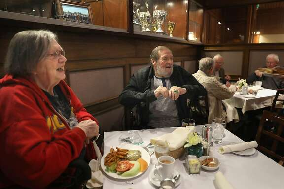 Past United Irish Cultural Center president Joan McClain (left) has lunch with present vice president Bill Luque (middle back) at the restaurant at the United Irish Cultural Center on Thursday, Oct. 18, 2018, in San Francisco, Calif.