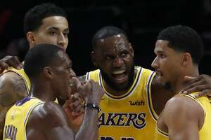 The Los Angeles Lakers' LeBron James (23) huddles with his teammates during the season-opener against the Portland Trailblazers at Moda Center in Portland, Ore., on Thursday, Oct. 18, 2018. (Luis Sinco/Los Angeles Times/TNS)