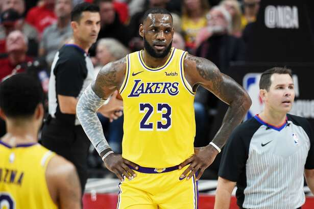 PORTLAND, OR - OCTOBER 18: LeBron James #23 of the Los Angeles Lakers argues with referee Brian Forte #45 in the first quarter of their game against the Portland Trail Blazers at Moda Center on October 18, 2018 in Portland, Oregon. NOTE TO USER: User expressly acknowledges and agrees that, by downloading and or using this photograph, User is consenting to the terms and conditions of the Getty Images License Agreement. (Photo by Steve Dykes/Getty Images)
