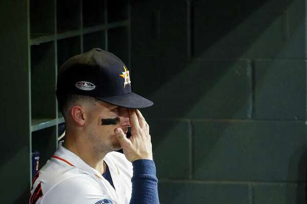 Alex Bregman takes a moment in the dugout after Game 5 to process the fact that the Astros have reached the end of the line.