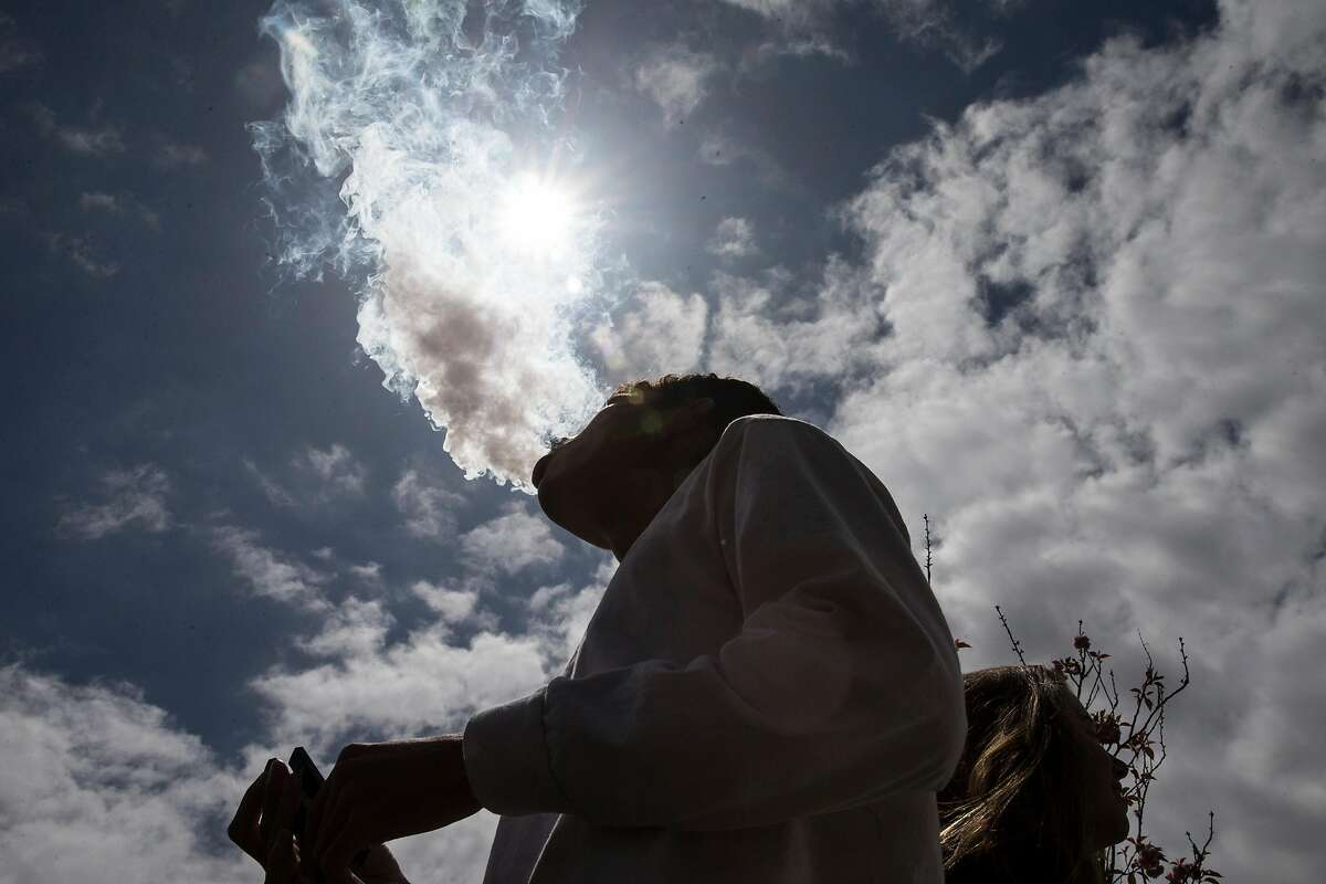 Agustin, a student of Bishop O'Dowd High School, smokes from a Juul e-cigarette at Mountain View Cemetery in Oakland, Calif. Wednesday, May 16, 2018.