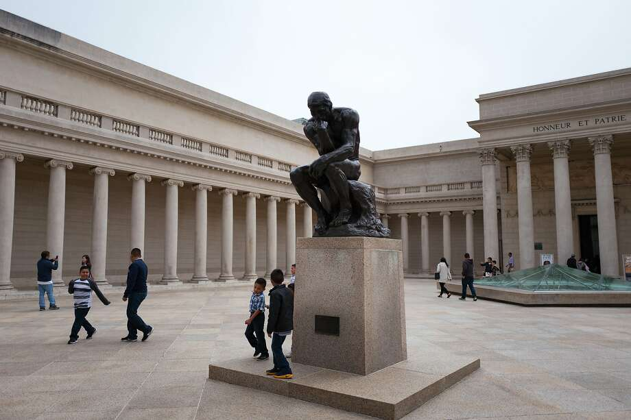 In the courtyard of the Legion of Honor art museum in the Lands End neighborhood of San Francisco, children play near The Thinker, a bronze statue by French artist Auguste Rodin.Beginning Oct. 19, residents of all nine counties of the Bay Area will be able to attend both the de Young and Legion of Honor Museums free of charge. Photo: Smith Collection/Gado, Getty Images