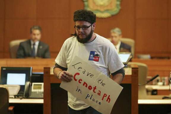 This is Texas Freedom Force member Paul Gescheidle leaves the podium after speaking against the proposed Alamo Plaza plan during the San Antonio City Council meeting on Oct. 18, 2018.