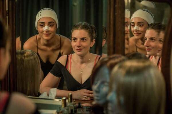 """Mona (Golshifteh Farahani) and Naomi (Neta Riskin) bond with some wigs during their stay in a Hamburg safehouse, in a scene from """"Shelter."""" The spy thriller is among the award-winning movies to be screened at the Israeli Film Festival at Danbury's Palace Theatre on Nov. 4."""