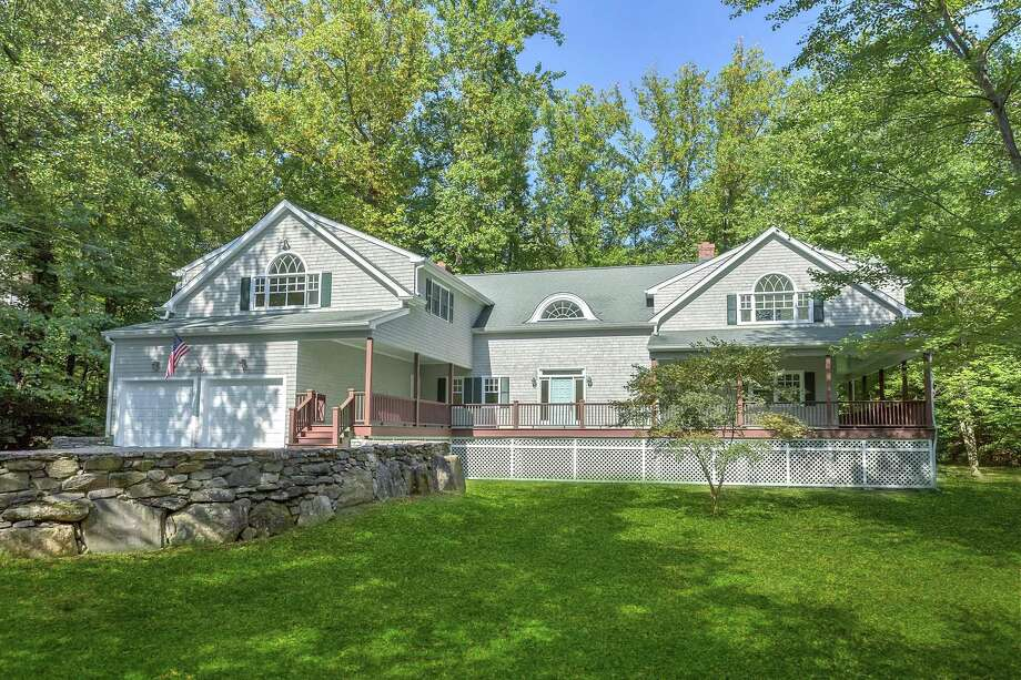 The colonial is on 1.2 acres at 236 Old Kings Highway North in the heart of Darien. The home includes a two-car attached garage and it is listed for $1.195 million. Photo: Halstead Connecticut / ONLINE_CHECK