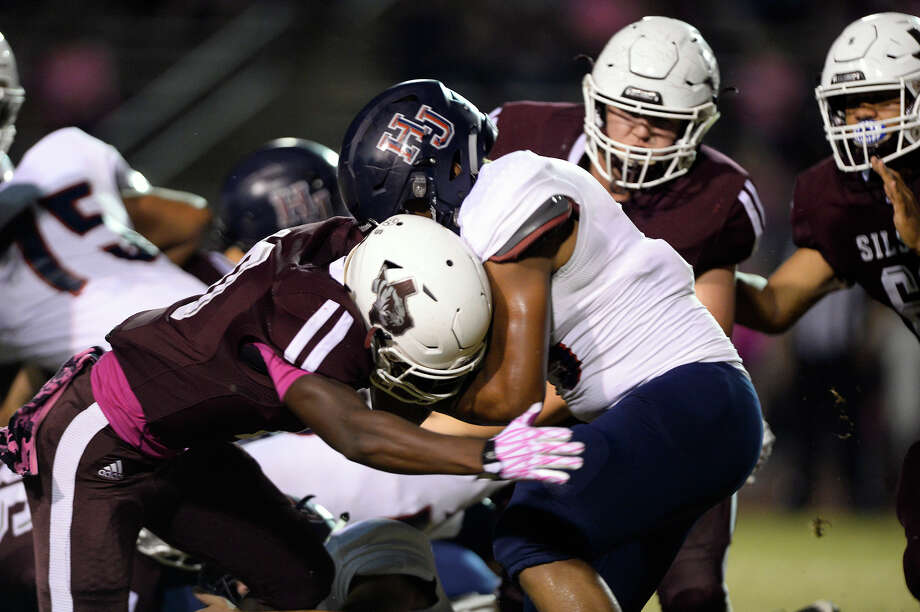 Hardin-Jefferson's Christian Bowie is hit by Silsbee defenders at Tiger Stadium on Friday night. 