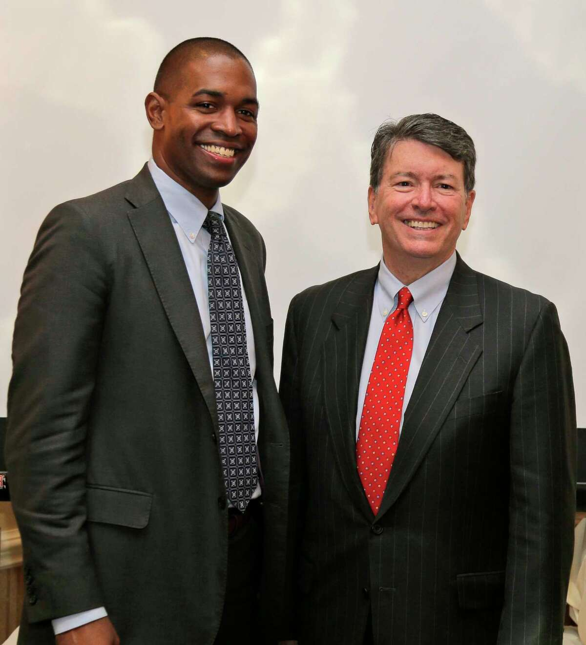 Republican U.S. Rep. John Faso, right, and his Democratic challenger, Antonio Delgado, pose for a picture after a candidate forum in Poughkeepsie, N.Y., Wednesday, Oct. 17, 2018. Hip-hop, health care and Brett Kavanaugh have emerged as issues in a too-close-to-call congressional race in New York?'s Hudson Valley that pits the freshman Republican congressman against a rapper-turned-corporate lawyer seeking his first political office. (AP Photo/Seth Wenig)
