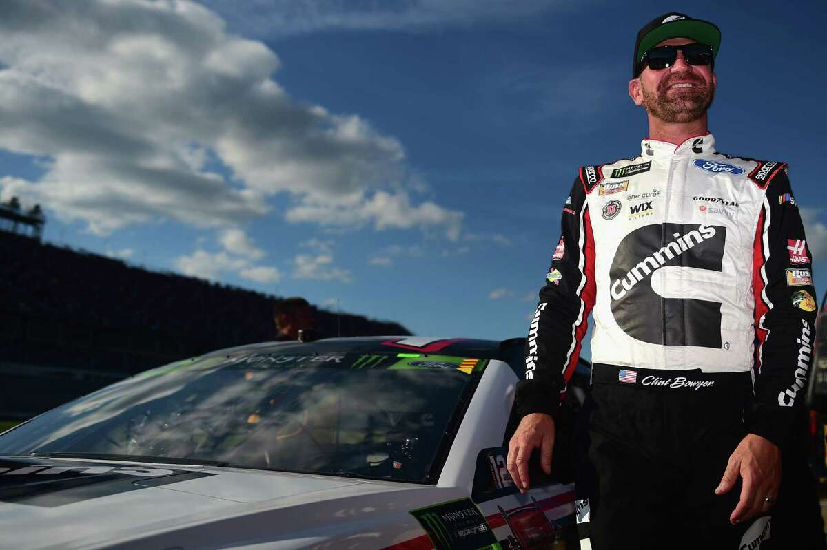 TALLADEGA, AL - OCTOBER 13: Clint Bowyer, driver of the #14 Cummins/Rush Truck Centers Ford, stands by his car during qualifying for the Monster Energy NASCAR Cup Series 1000Bulbs.com 500 at Talladega Superspeedway on October 13, 2018 in Talladega, Alabama. (Photo by Jared C. Tilton/Getty Images)