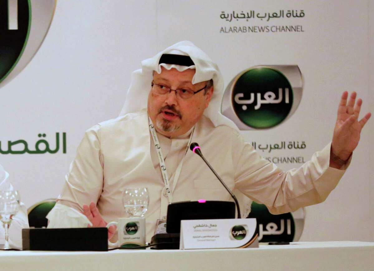FILE - In this Dec. 15, 2014 file photo, Jamal Khashoggi, then general manager of a new Arabic news channel speaks during a press conference, in Manama, Bahrain. Khashoggi was a Saudi insider. He rubbed shoulders with the Saudi royal family and supported its efforts to nudge the entrenched ultraconservative clerics to accept reforms. He was a close aide to the kingdom?'s former spy chief and was a leading voice in the country?'s prominent dailies. In a dramatic twist of fate, Khashoggi disappeared on Tuesday, Oct. 2, 2018, after visiting his country?'s consulate in Istanbul and may have been killed there. (AP Photo/Hasan Jamali, File)
