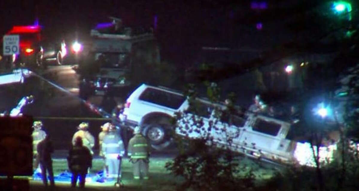 A 2001 Ford Excursion enhanced limo owned by Prestige Limousine is pulled from the crash scene on Saturday, Oct. 6, 2018. The company's SUV-style stretch limousine crashed at 1:55 p.m. Saturday near the intersection of Route 30 and Route 30A, killing the driver, 17 passengers and two bystanders who were standing outside the Apple Barrel Country Store in Schoharie. (Photo courtesy of WRGB (CBS-6)