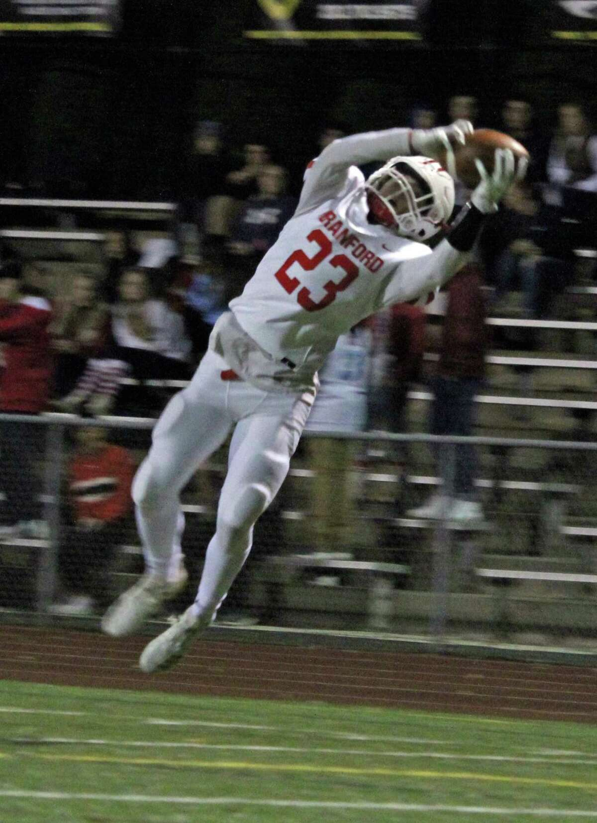 Branford's Robert Lionetti lays out for a catch during an SCC matchup between Law and Branford on Friday, Oct. 19, 2018 at Jonathan Law High School in Milford, Conn. Law defeated Branford 35-6.