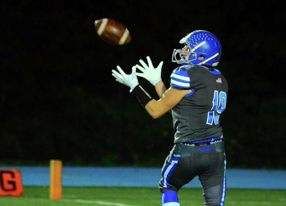 Bunnell's James Savko completes a pass in the end zone to score a touchdown against Masuk during high school football action in Stratford, Conn., on Friday Oct. 19, 2018. Photo: Christian Abraham / Hearst Connecticut Media / Connecticut Post