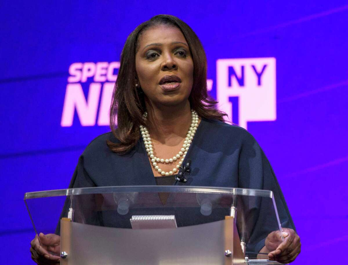 FILE - In this Aug. 28, 2018, file photo, candidate Letitia James stands at the podium during a debate by the Democratic candidates for New York State Attorney General at John Jay College of Criminal Justice in New York. The four candidates in the tightly contested primary, Zephyr Teachout, James, U.S. Rep. Sean Patrick Maloney and Leecia Eve have all vowed to be a legal thorn in Republican President Donald Trump's side, opposing his policies on immigration and the environment. And the winner will inherit several pending lawsuits filed by the state that challenge Trump's policies and accuse his charitable foundation of breaking the law. (Holly Pickett/The New York Times via AP, Pool, File)