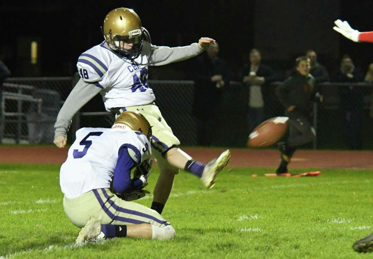 CBA kicker Owen Naef (48) kicks the ball for an extra point following a touchdown against Guilderland during a game on Friday, Oct. 19, 2018 in Guilderland, N.Y. (Jenn March, Special to the Times Union )