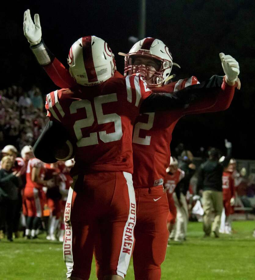 Guilderland tight end Nick Popolizio chest bumps running back Vin Lia following a touchdown by Lia during a game against CBA on Friday, Oct. 19, 2018  in Guilderland, N.Y. (Jenn March, Special to the Times Union ) Photo: Jenn March / © Jenn March 2018 © Albany Times Union 2018
